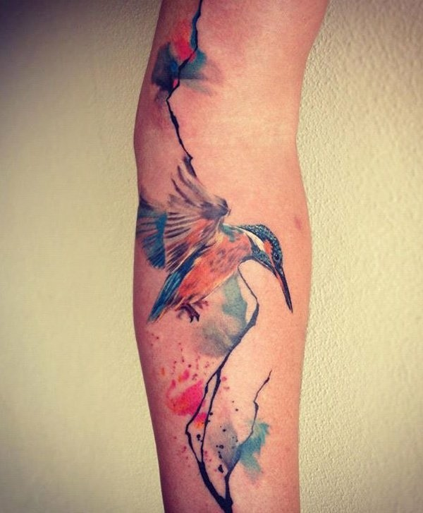 tatouage-bras-avant-bras-style-aquarelle-colibri