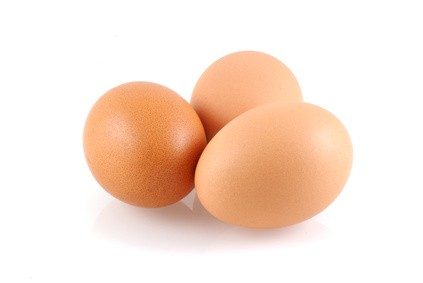 Three eggs, isolated on a white background.